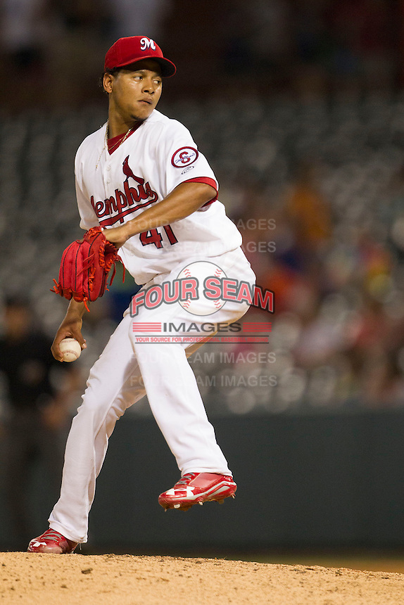 Memphis Redbirds starting pitcher Carlos Martinez (41) delivers a pitch against the New Orleans Zephyrs in the Pacific Coast League baseball game on June 12, 2013 at Autozone Park in Memphis, Tennessee. Memphis defeated New Orleans 9-3. (Andrew Woolley/Four Seam Images)