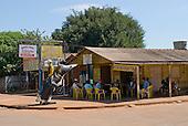 Mato Grosso State, Brazil. Bang Bang, Sao José do Xingu; Bar in a wooden shack with fibreglass rodeo cowboy.