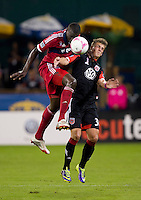 Bakary Soumare (4) of the Chicago Fire goes up for a header with <br /> Conor Doyle (30) of D.C. United during a Major League Soccer game at RFK Stadium in Washington, DC.  The Chicago Fire defeated D.C. United, 3-0.