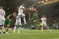 Portland, Oregon - Wednesday September 25, 2019: Larrys Mabiala #33 challenges for the ball during a regular season game between Portland Timbers and New England Revolution at Providence Park on September 25, 2019 in Portland, Oregon.