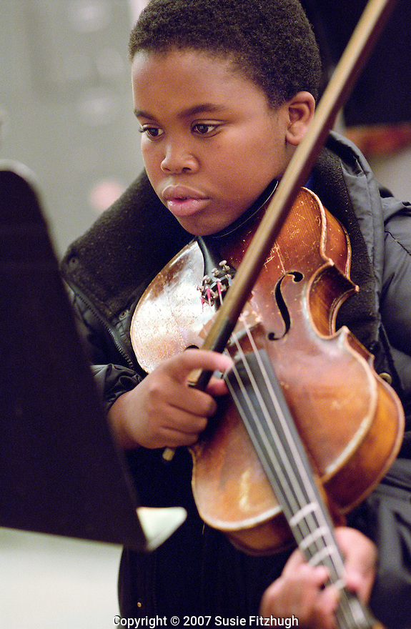 Middleschool violin student at Denny Middle School in Seattle.