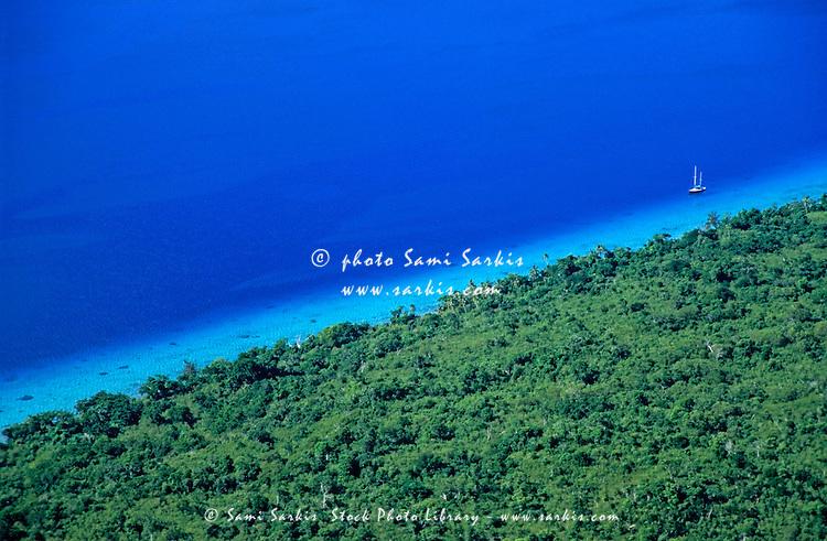 Lush coast and blue waters of the sea surrounding Mosso Island, Vanuatu.