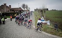 peloton coming off the Haaghoek<br /> <br /> 76th Omloop Het Nieuwsblad 2021<br /> ME(1.UWT)<br /> 1 day race from Ghent to Ninove (BEL): 200km<br /> <br /> ©kramon