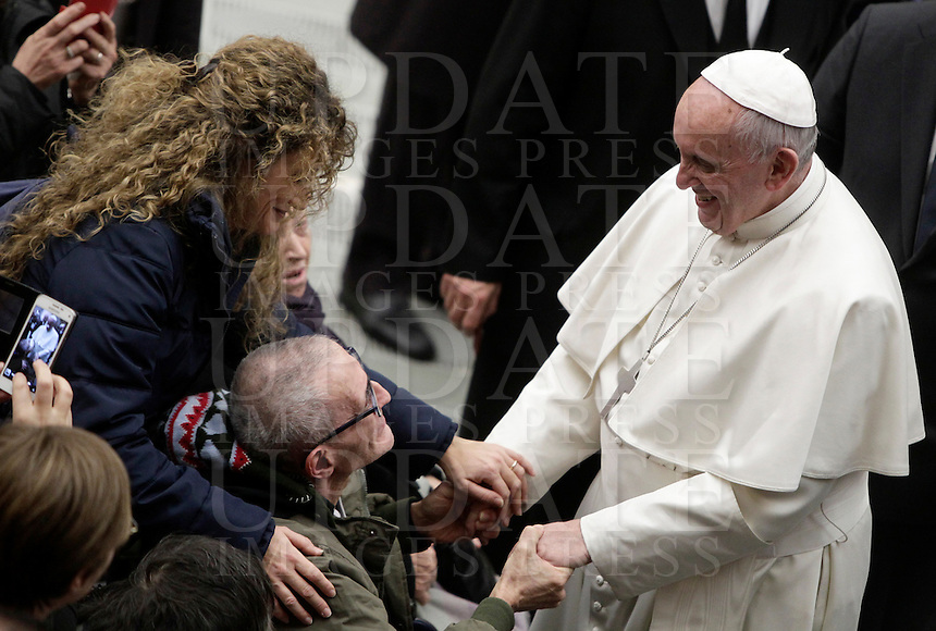 Papa Francesco saluta i fedeli al termine dell'Udienza Generale del mercoledi' in aula Paolo VI, Citta' del Vaticano, 14 dicembre 2016.<br /> Pope Francis greets faithful at the end of his weekly general audience in Paul VI Hall at the Vatican, on December 14, 2016.<br /> UPDATE IMAGES PRESS/Isabella Bonotto<br /> <br /> STRICTLY ONLY FOR EDITORIAL USE