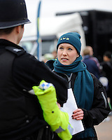 An LV= member of staff mixes with police in the LV= family area at the Aviva Premiership match between Harlequins and Saracens at Twickenham on Tuesday 27 December 2011 (Photo by Rob Munro)