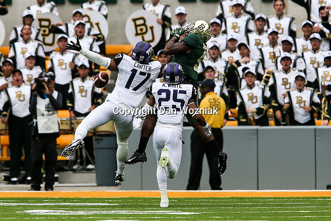 Baylor Bears and TCU Horned Frogs players, cheerleaders and fans in action during the game between the TCU Horned Frogs and the Baylor Bears at the McLane Stadium in Waco, Texas. Baylor defeated TCU 61 to 58.