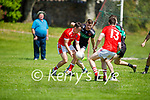 St Pats Tommy Lynch goes in search of a score as Churchills Joe Lenihan bears down on him in the County Senior football league on Sunday.