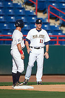 Brevard County Manatees Mitch Ghelfi (4) looks to manager Joe Ayrault (11) for the signs during a game against the Daytona Tortugas on August 14, 2016 at Space Coast Stadium in Viera, Florida.  Daytona defeated Brevard County 9-3.  (Mike Janes/Four Seam Images)