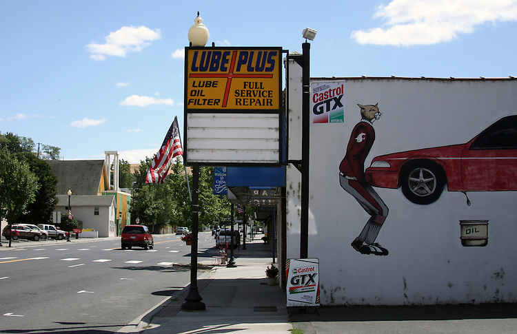 """""""Cougar"""" painted on the side of a building in downtown Colfax, Washington."""