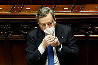 The Italian Prime Minister Mario Draghi adjusting his face mask at the Chamber of Deputies during the discussion and vote of confidence in the new Government. Rome (Italy), February 18th 2021<br /> Photo Samantha Zucchi Insidefoto