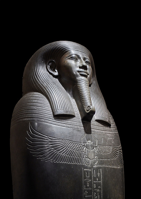 Ancient Egyptian greywacke sarcophagus of Vizier Gemenefherbak - late Period, 26th Dynasty (664-525BC). Egyptian Museum, Turin. black background<br /> <br /> Gemenefherbak was a vizier, minister, as indicated by a pendant picturing the goddess Maat hanging around his neck in the shadow of his beard. Despite the hardness of the greywacke stone the sarcophagus is made from, its makers have shown incredible skill creating a sarcophagus with intricate detail and a highly polished finish.