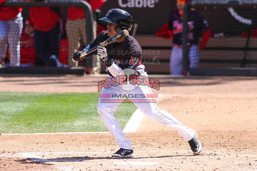 Wisconsin Timber Rattlers second baseman Gregory Munoz (7) squares to bunt during a game against the Peoria Chiefs on April 25th, 2015 at Fox Cities Stadium in Appleton, Wisconsin.  Wisconsin defeated Peoria 2-0.  (Brad Krause/Four Seam Images)