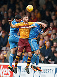 Louis Moult wins the ball from Anthony O'Connor and Stevie May