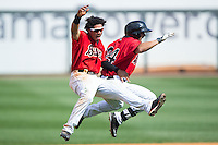 Jacob May (left) and Christian Marrero (24) celebrate after Marerro drove in 2 runs in the bottom of the 13th inning for a 4-3 walk-off win over the Tennessee Smokies at Regions Field on May 4, 2015 in Birmingham, Alabama.  (Brian Westerholt/Four Seam Images)