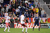 Shalrie Joseph (21) of the New England Revolution heads the ball over Rafael Marquez (4) of the New York Red Bulls. The New York Red Bulls defeated the New England Revolution 2-0 during a Major League Soccer (MLS) match at Red Bull Arena in Harrison, NJ, on October 21, 2010.