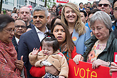 Tulip Siddiq, daughter Azalea, and London Mayor Sadiq Khan at the launch of her campaign to retain Hampstead and Kilburn, the tenth most marginal Labour parliamentary seat in the UK. Swiss Cottage, London.