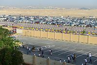 QATAR, Doha, religious complex with churches, parking place and Mall Ansar in the back / KATAR, Doha, Religionskomplex mit Kirchen am Stadtrand, Parkplatz und Mall Ansar Gallery im Hintergrund