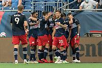 FOXBOROUGH, MA - JULY 25: Gustavo Bou #7 of New England Revolution celebrates his goal with teammates during a game between CF Montreal and New England Revolution at Gillette Stadium on July 25, 2021 in Foxborough, Massachusetts.