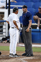 July 11, 2009:  Omar Malave of the Dunedin Blue Jays argues a call with umpire Travis Carlson during a game at Dunedin Stadium in Dunedin, FL.  Dunedin is the Florida State League High-A affiliate of the Toronto Blue Jays.  Photo By Mike Janes/Four Seam Images