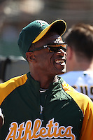 OAKLAND, CA - SEPTEMBER 12:  Instructor Rickey Henderson #35 of the Oakland Athletics watches from the dugout during the game against the Boston Red Sox at the Oakland-Alameda County Coliseum on September 12, 2010 in Oakland, California. Photo by Brad Mangin