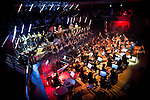"""© Joel Goodman - 07973 332324 . 05/02/2016 . Manchester , UK .  """" Hacienda Classical """" debut at the Bridgewater Hall . The 70 piece Manchester Camerata and performers including New Order's Peter Hook , Shaun Ryder , Rowetta Idah , Bez and Hacienda DJs Graeme Park and Mike Pickering mixing live compositions . Photo credit : Joel Goodman"""