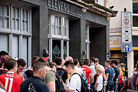 "Pictured: Queues of people outside Elevens Bar in Cardiff, Wales, UK. Thursday 12 July 2018<br /> Re: Last night (Thurday 12 July) Elevens Bar & Grill and the Football Association of Wales jointly hosted a Q&A evening with Gareth Bale. At the event, Gareth unveiled a new piece of memorabilia for Elevens – his match worn boots from this year's Champions League Final with which he scored that incredible overhead kick.<br /> The event, hosted at Elevens Bar & Grill was open to members of the public with doors opening at 6pm on Thursday evening. People started queueing from 3pm, with a cross-section of fans of all ages in Wales shirts and bucket hats. <br /> The Q&A, conducted by Ian Gwyn Hughes from the FAW, discussed all aspects of his career so far, from growing up in Cardiff to winning 4 Champions League medals with Real Madrid. On growing up in Whitchurch, Gareth said: ""My family were a huge influence on me growing up. My parents were so supportive, taking me here there and everywhere so I could play football. Growing up I can hardly remember not being with a football – I even took one to bed!""<br /> There were a lot of youngsters in the audience, eager to hear from their hero. Gareth's advice to them? ""Work hard for what you want and who knows where that could take you.""<br /> As a left-footer, Ryan Giggs,  Wales' national team manager was someone he looked up to growing up. Gareth mentioned it was great to beat Ian Rush's goal scoring record for Wales with his childhood idol as manager. ""I knew I'd levelled his record at half time, I needed one more to break it. The manager wanted to take me off but I said give me another 15 minutes to see if I can do it. Luckily on 61 minutes our goalkeeping coach took too long to do the substitution on the paper, so it gave me an extra minute. It worked out perfectly."""