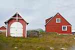 A church cross and red houses in Nuuk, Greenland.