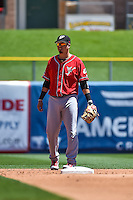 Ramiro Pena (12) of the El Paso Chihuahuas on defense against the Salt Lake Bees in Pacific Coast League action at Smith's Ballpark on July 26, 2015 in Salt Lake City, Utah. El Paso defeated Salt Lake 6-3 in 10 innings.  (Stephen Smith/Four Seam Images)