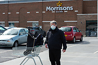 A shopper in the queue at Morrisons during the Coronavirus pandemic at Sidcup, Kent, England on 2 April 2020. Photo by Alan Stanford.
