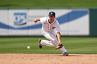 Detroit Tigers shortstop Cole Peterson (21) fields a ground ball during a Minor League Spring Training game against the Philadelphia Phillies on April 17, 2021 at Joker Marchant Stadium in Lakeland, Florida.  (Mike Janes/Four Seam Images)