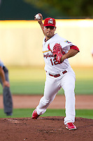 Richard Castillo (12) of the Springfield Cardinals delivers a pitch during a game against the Northwest Arkansas Naturals at Hammons Field on June 14, 2012 in Springfield, Missouri. (David Welker/Four Seam Images)