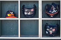 Virginia Cavaliers helmet rack on June 19, 2015 at TD Ameritrade Park in Omaha, Nebraska. (Andrew Woolley/Four Seam Images)