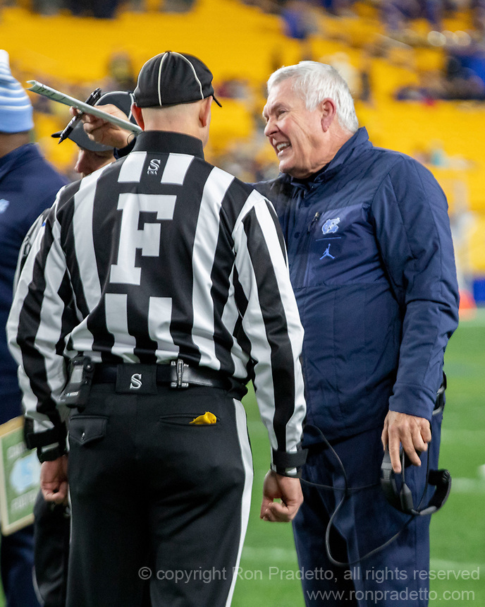 North Carolina head coach successfully challenges the touchdown catch of Shocky Jacques-Louis with the field judge. The Pitt Panthers defeated the North Carolina Tarheels 34-27 in overtime in the football game on November 14, 2019 at Heinz Field, Pittsburgh, Pennsylvania.