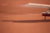 11-07-13, Netherlands, Scheveningen,  Mets, Tennis, Sport1 Open, day four, Sweeping the clay court<br /> <br /> <br /> Photo: Henk Koster
