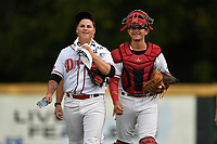 Starting pitcher Jhonathan Diaz (31) of the Greenville Drive walks in from the bullpen with catcher Samuel Miranda (21) before a game against the Lexington Legends on Sunday, September 2, 2018, at Fluor Field at the West End in Greenville, South Carolina. Greenville won, 7-4. (Tom Priddy/Four Seam Images)