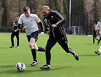 Thursday 11 April 2013<br /> Pictured: Goalkeeping coach Adrian Tucker (R) against a sport reporter.<br /> Re: Friendly game, Swansea City FC coaching staff v sports reporters at the Swansea City FC training ground. Final score 10-4.