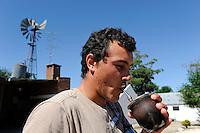 URUGUAY Colonia Delta near San Jose, man drinks Mate tea