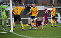 Arbroath's Bobby Linn (back of pic in distance) starts his celebration after scores their first goal.