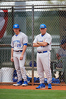 Central Connecticut State Blue Devils coach Jim Ziogas (19) and Mike Appel (26) watch practice before a game against the North Dakota State Bison on February 23, 2018 at North Charlotte Regional Park in Port Charlotte, Florida.  North Dakota State defeated Connecticut State 2-0.  (Mike Janes/Four Seam Images)