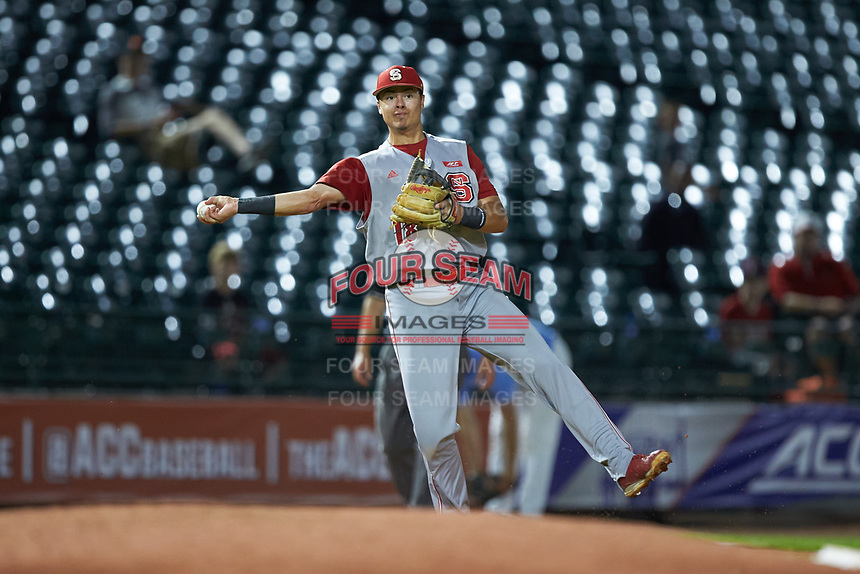 Evan Mendoza (18) of the North Carolina State Wolfpack makes a throw to first base against the North Carolina Tar Heels in Game Twelve of the 2017 ACC Baseball Championship at Louisville Slugger Field on May 26, 2017 in Louisville, Kentucky. The Tar Heels defeated the Wolfpack 12-4. (Brian Westerholt/Four Seam Images)