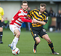 Hamilton's Anthony Andreu and Alloa's Graeme Holmes challenge for the ball.