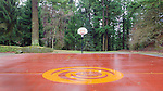 Outdoor Basketball, Mt. Tabor Park, Portland, Oregon.  Stone walls, wooden benches, stage, public, winter, evergreen, public, Portland Parks and Recreation, popular, tourism, moss, lichen, cedar trees, seating, events, venue.