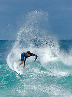 Surfer cutting wave. Oahu, Hawaii