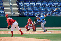 Charlotte Stone Crabs right fielder Cade Gotta (20) hits a pitch from Tom Eshelman (39) while at bat in front of catcher Chace Numata (50) and umpire Mike Savakinas during a game against the Clearwater Threshers on April 13, 2016 at Bright House Field in Clearwater, Florida.  Charlotte defeated Clearwater 1-0.  (Mike Janes/Four Seam Images)