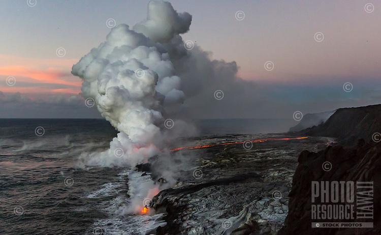 Kamokuna Lava Bench: A river of lava makes its way to the ocean, simultaneously creating new land and a huge steam plume, Kamokuna, Hawai'i Volcanoes National Park, Big Island of Hawai'i.