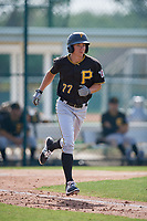 Pittsburgh Pirates shortstop Andrew Walker (77) runs to first base during a minor league Extended Spring Training intrasquad game on April 1, 2017 at Pirate City in Bradenton, Florida.  (Mike Janes/Four Seam Images)