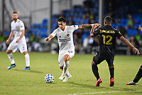 LAKE BUENA VISTA, FL - JULY 18: Cristian Pavón #10 of LA Galaxy prepares to shoot around Diego Palacios #12 of LAFC during a game between Los Angeles Galaxy and Los Angeles FC at ESPN Wide World of Sports on July 18, 2020 in Lake Buena Vista, Florida.
