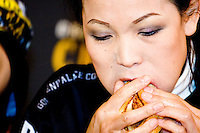 """Sonya Thomas aka """"The Black Widow"""" eats as quickly as possible at the I.F.O.C.E. sanctioned Grilled Cheese Eating Competition, held in New York City on February 1, 2006."""