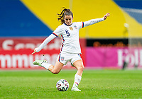 SOLNA, SWEDEN - APRIL 10: Kelley O'Hara #5 of the USWNT crosses the ball during a game between Sweden and USWNT at Friends Arena on April 10, 2021 in Solna, Sweden.