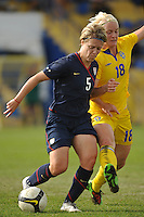 US Women's National Team players Lori Lindsey is challenged vs Sweden in the Algarve Cup during a match in Ferreiras, Portugal on March 1, 2010.